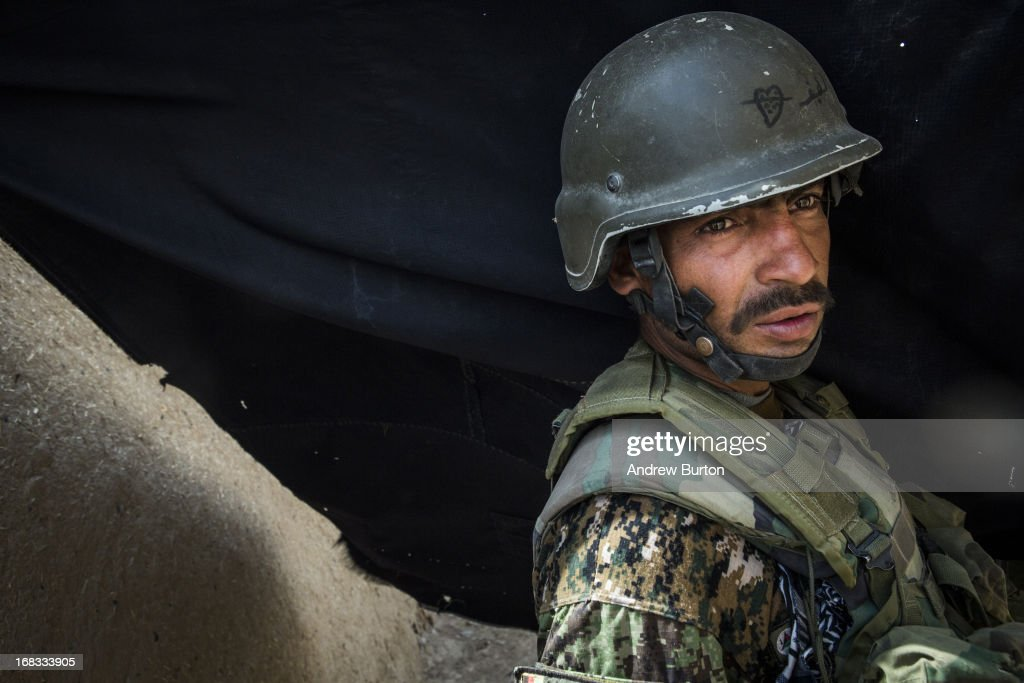A soldier in the Afghan National Army's 6th Kandak (battalion), 3rd company searches a compound during a joint patrol with the U.S. Army's 1st Battalion, 36th Infantry Regiment near Command Outpost Pa'in Kalay on April 6, 2013 in Kandahar Province, Maiwand District, Afghanistan. The United States military and its allies are in the midst of training and transitioning power to the Afghan National Security Forces in order to withdraw from the country by 2014.
