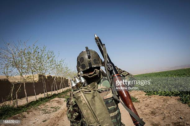 A soldier in the Afghan National Army's 6th Kandak carries a rocketpropelled grenade launcher during a joint patrol with United States forces near...