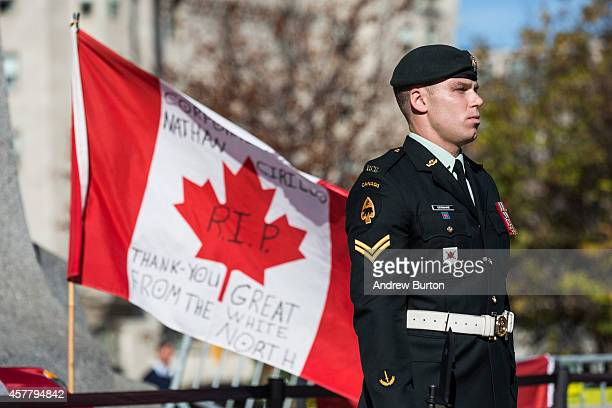 A soldier in the Canadian Army stands guard at the National War Memorial during a ceremony at the memorial on October 24 2014 in Ottawa Canada Two...