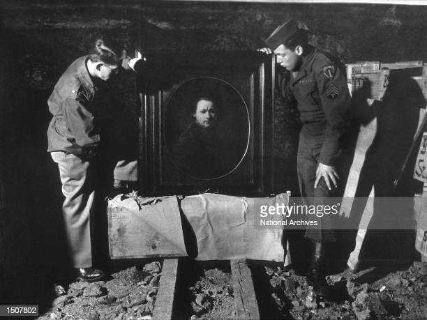 A US soldier inspects priceless art taken from jews by the Nazi's and stashed in the Heilbron Salt Mines May 3 1945 in Germany The treasures were...