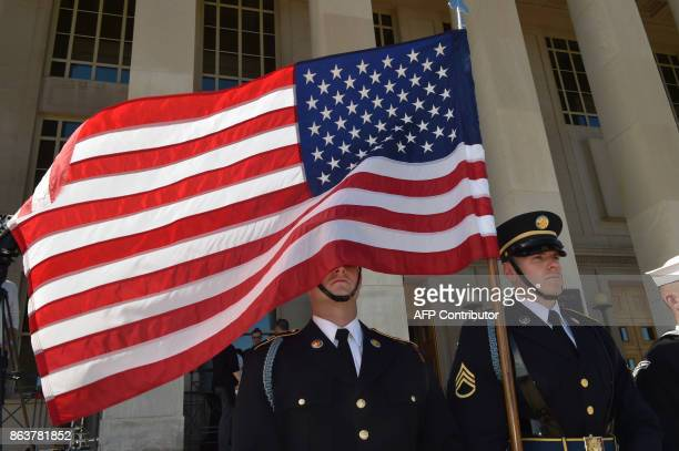 A soldier is blinded by the US flag as US Secretary of Defense Jim Mattis hosts Florence Parly French Defense minister at the Pentagon for a meeting...