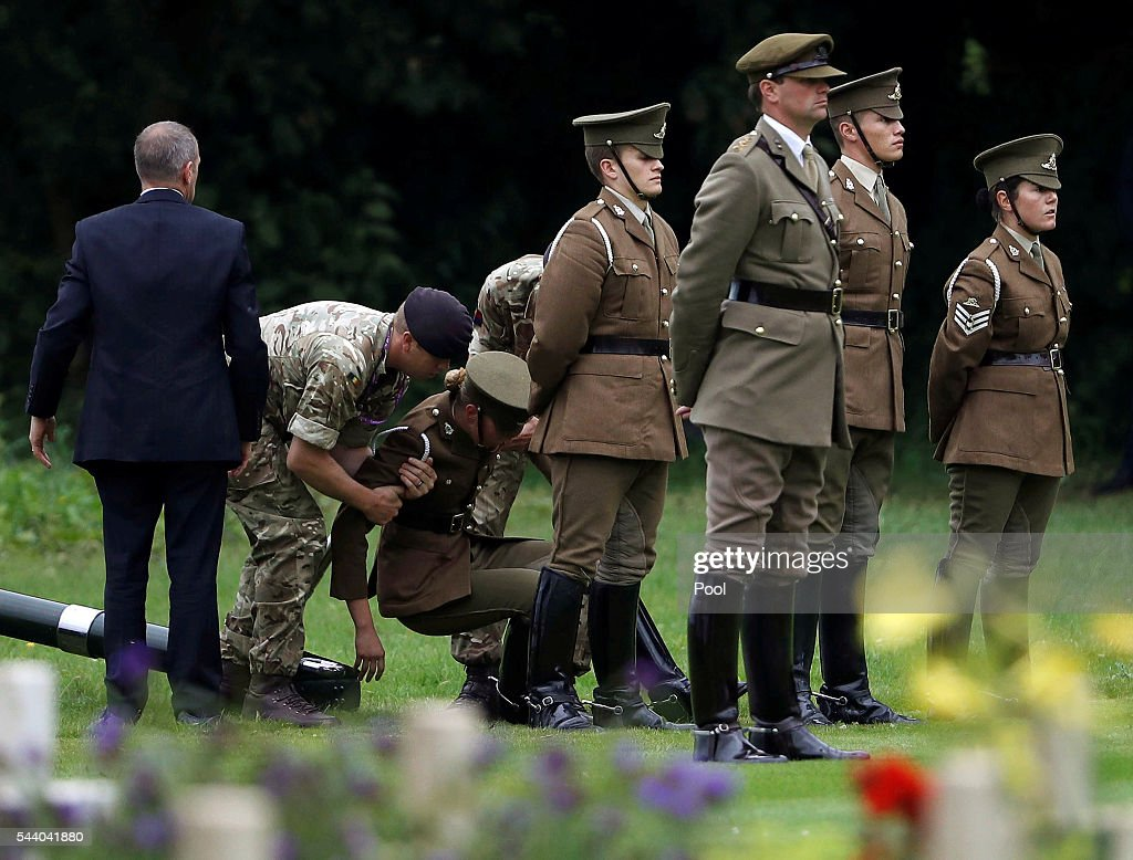 A soldier is helped after fainting during the 100th anniversary of the beginning of the Battle of the Somme at the Thiepval memorial to the Missing on July 1, 2016 in Thiepval, France. The event is part of the Commemoration of the Centenary of the Battle of the Somme at the Commonwealth War Graves Commission Thiepval Memorial in Thiepval, France, where 70,000 British and Commonwealth soldiers with no known grave are commemorated.