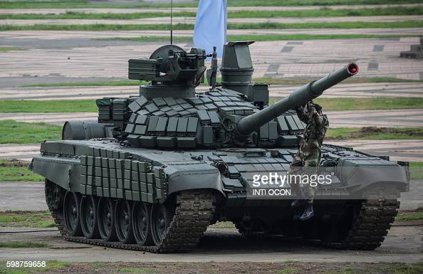 A soldier jumps from the top of a Russianmade T72B1 Main battle tank Purchased by Nicaragua during Army's 37th anniversary at la Fe Square in Managua...