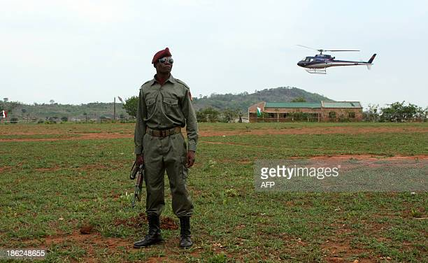 A soldier keeps watch as a helicopter part of Mozambique's President Armando Guebuza entourage lands in Catandica on October 29 2013 Mozambique...