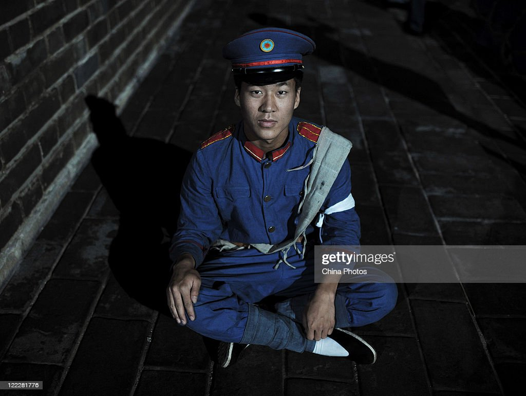 Soldier <a gi-track='captionPersonalityLinkClicked' href=/galleries/search?phrase=Li+Bin&family=editorial&specificpeople=227305 ng-click='$event.stopPropagation()'>Li Bin</a>, 22, from air force dressed in the New Army uniform poses for a photo while taking part in a reenactment of the 1911 Revolution to mark the upcoming 100th anniversary of Wuchang Uprising, at the Qiyi Gate (former name 'Zhonghe Gate') on August 25, 2011 in Wuhan of Hubei Province, China. This year marks the 100th anniversary of Wuchang Uprising of October 10, 1911 that started the 1911 Xinhai Revolution, led by Chinese leader Sun Yat-sen, which dethroned the feudal domination of Qing Dynasty.