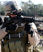 December 18-20, 2007 - An Explosive Ordinance Disposal technician looks at an improvised explosive device through the scope of a M-4 carbine. Marines from 2nd Explosive Ordinance Disposal Company, 8th