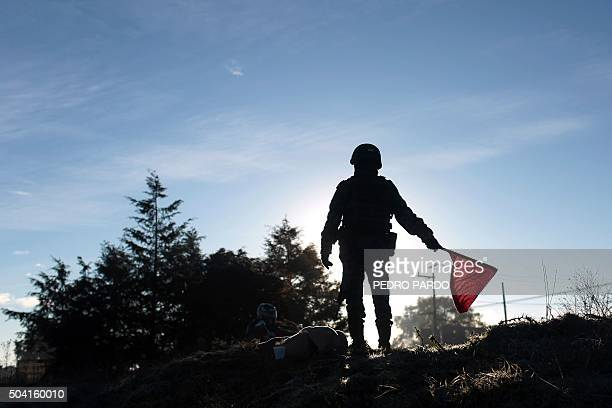 A soldier makes signs at a checkpoint near the Almoloya prision where drug kingpin Joaquin Guzman Loera 'El Chapo Guzman' was readmitted on the eve...