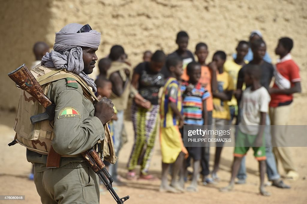 A soldier of FAMa stands guard on June 4 at Goundam 80 km east of Timbuktu central Mali during a joint operation 'La Madine 3' with Malian forces and...