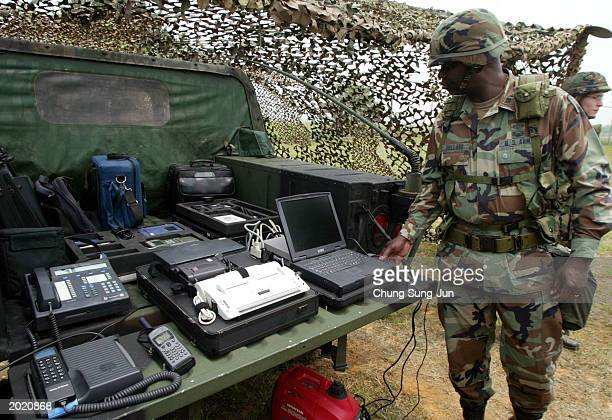 S soldier of the 501th Military Intelligence Brigade stands in front of a communication system during an intelligence capabilities display at the US...