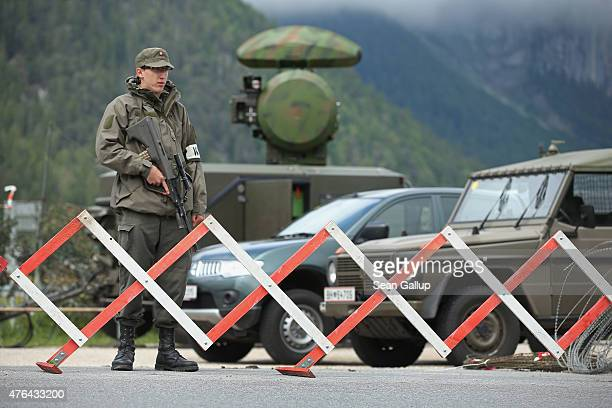 A soldier of the Austrian army stands next to a mobile radar station that is safeguarding the upcoming Bilderberg conference on June 9 2015 near...