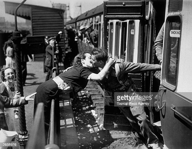 A soldier of the British Expeditionary Force arriving back from Dunkirk is greeted affectionately by his girlfriend