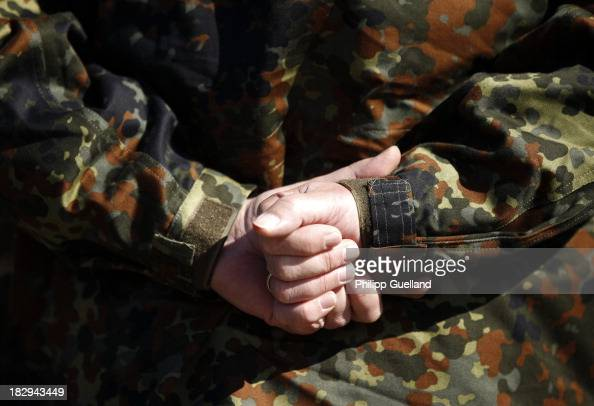 Soldier of the Bundeswehr folds his hands behind his back during the annual military exercises held for the media at the Bergen military training...