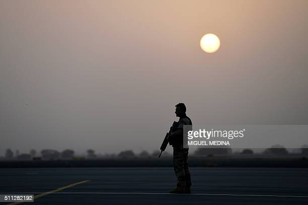 A soldier of the France's Barkhane counterterrorism operation in Africa's Sahel region stand in position at the international airport of Bamako on...