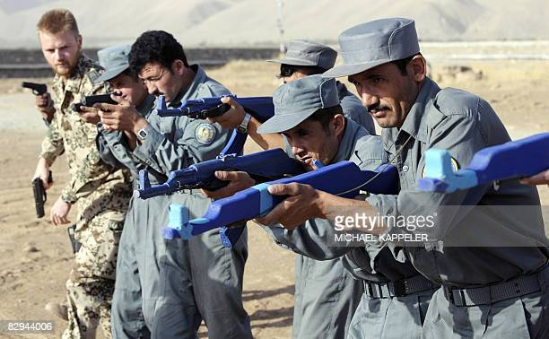 A soldier of the German military police overlooks training of Afghan police officers in Faizabad in northern Afghanistan on September 21 2008The...