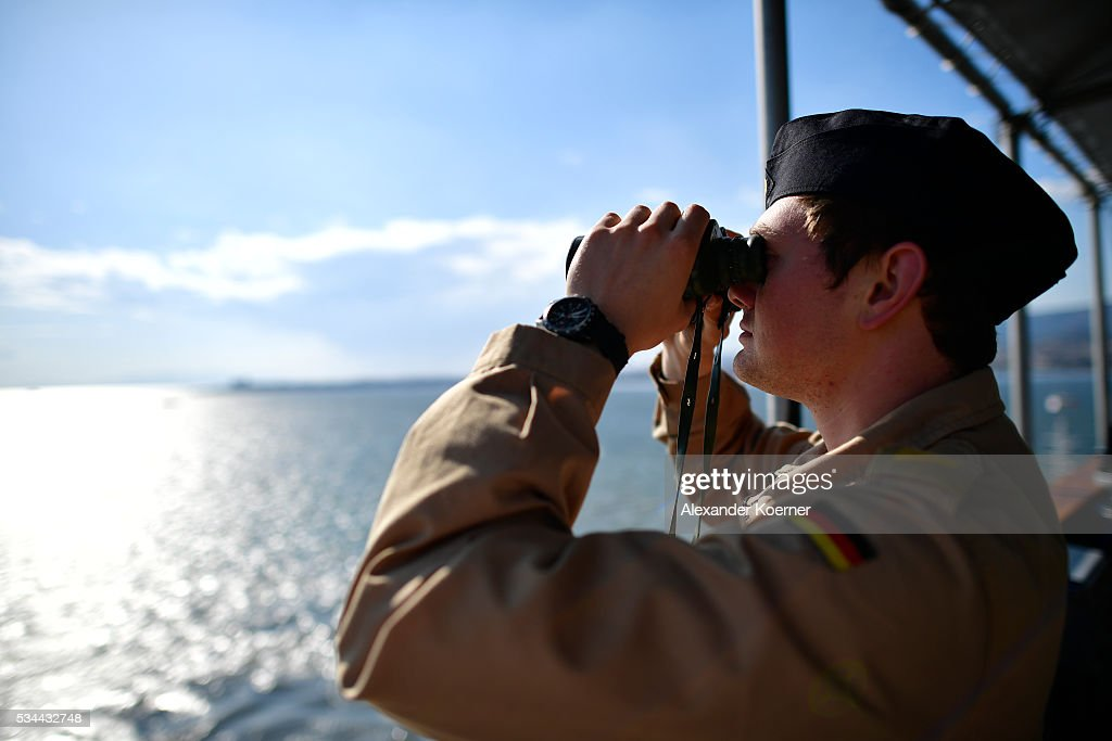 A soldier of the German Navy looks through a binocular while on board of the German combat support ship 'Bonn' at the port of Izmir on May 26, 2016 in Izmir, Turkey. NATO's Standing Maritime Group 2 is currently deployed in the region between the mainland of Greece and Turkey, and will conduct surveillance and monitor illegal crossings in the Aegean Sea. The number of attempts by refugees to reach the islands of Greece has dropped rapidly.