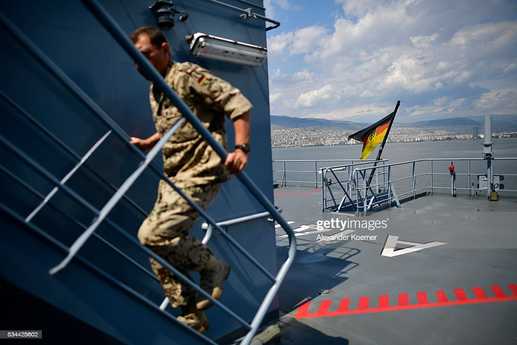 A soldier of the German navy walks a ladder at the German combat support ship 'Bonn' at the bay of Izmir on May 26, 2016 in Izmir, Turkey. NATO's Standing Maritime Group 2 is currently deployed in the region between the mainland of Greece and Turkey, and will conduct surveillance and monitor illegal crossings in the Aegean Sea. The number of attempts by refugees to reach the islands of Greece has dropped rapidly.