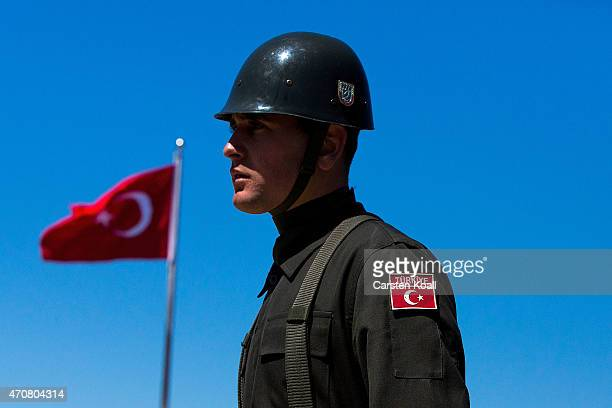 A soldier of the Turkish Army stands guard during an exercise one day before the upcoming Dawn Service commemoration ceremony to honour Australian...