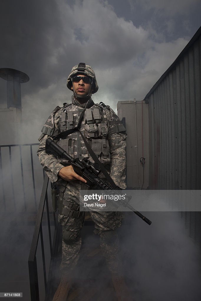 Soldier on rooftop : Stock Photo