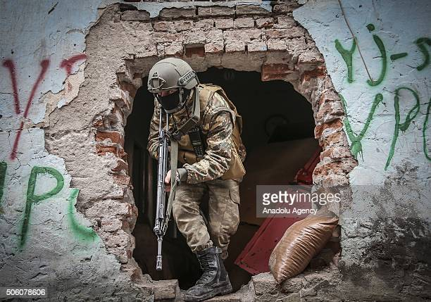 A soldier patrols at a street as Turkish Security Forces carry out a counter terrorism operation against terrorist organization PKK in Turkey's...