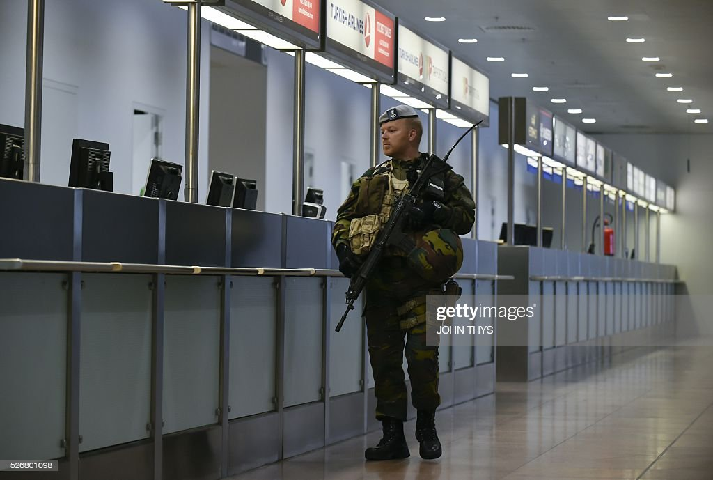 A soldier patrols during the partial reopening of the departure hall of Brussels Airport in Zaventem on May 1, 2016, after it was badly damaged in twin suicide attacks on March 22, that killed 16 people. A total of 32 people were killed and more than 300 wounded in coordinated suicide bombings at the airport and a metro station in central Brussels on March 22 in Belgium's worst ever terror attacks. / AFP / JOHN