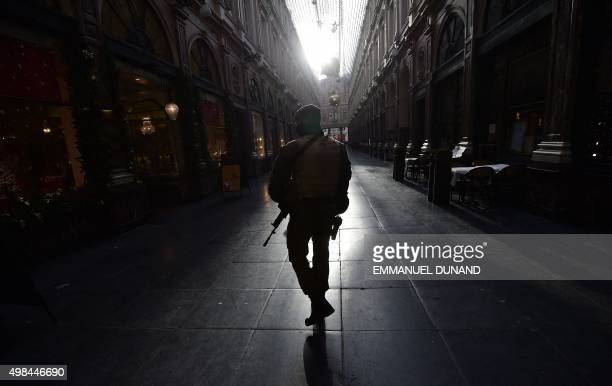 A soldier patrols in an empty shopping galery as the Belgian capital remains on the highest possible alert level in Brussels on November 23 2015...