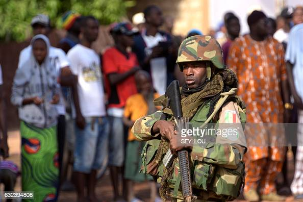 soldier patrols in front of the Second Battalion Camp in Farafegny near the frontier with Senegal on January 22 2017 West African troops approached...