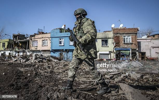 A soldier patrols on a street as Turkish Security Forces carry out a counter terrorism operation against terrorist organization PKK in Turkey's...