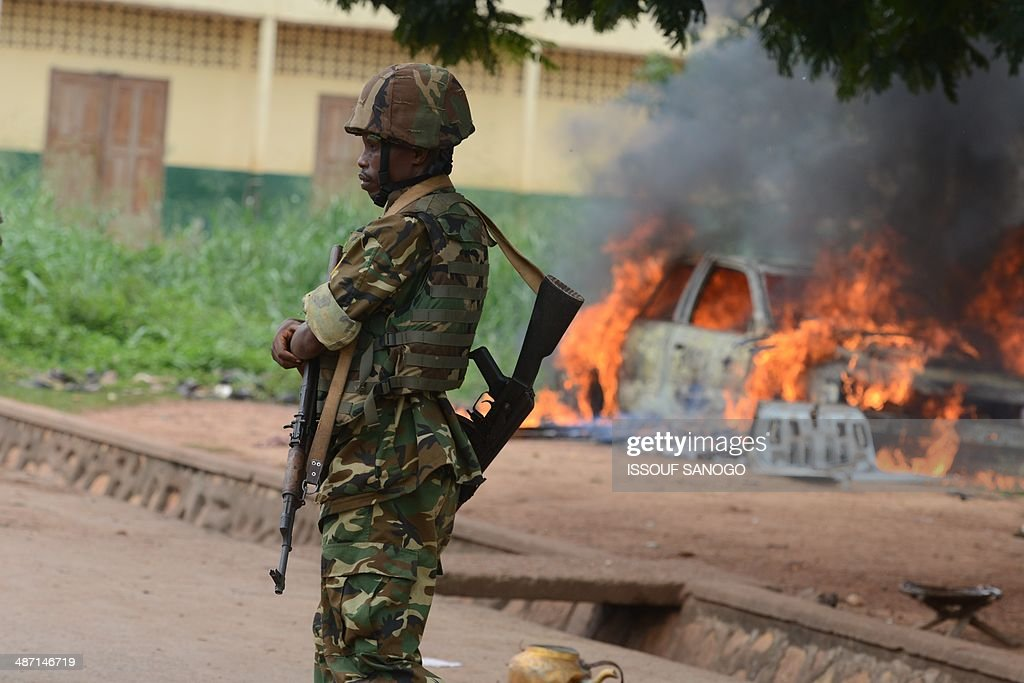 A MISCA soldier patrols, on April 27, 2014 in Bangui, after about 1.300 Muslims who were hiding in the PK12 district left in a convoy escorted by the Misca African force, to be relocated in the north of the country.