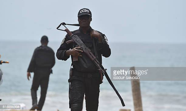 A soldier patrols on the beach on March 14 2016 in Grand Bassam a day after gunmen attacked the Ivory Coast resort town popular with Ivorians and...