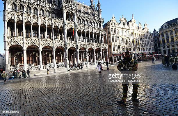 A soldier patrols on the Grand Place as the Belgian capital remains on the highest possible alert level on November 23 2015 in Brussels Brussels...