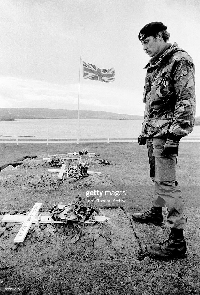 A soldier pays his respects at the grave of Lieutenant-Colonel H. Jones (1940-1982) at the Blue Beach War Cemetery in Port San Carlos in the Falkland Islands, October 1982. Jones was a posthumous recipient of the Victoria Cross.