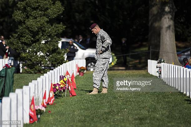 Soldier pays his respects to a loved one killed in the wars in Iraq and Afghanistan on Veterans Day at Arlington National Cemetery in Washington USA...