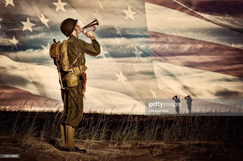 WWII Soldier Playing Taps With Flag Horizon : Stock Photo