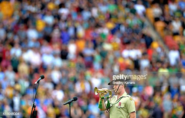 A soldier plays 'The Last Post' on his bugel before the TransTasman Test match between the Australia Kangaroos and the New Zealand Kiwis at Suncorp...