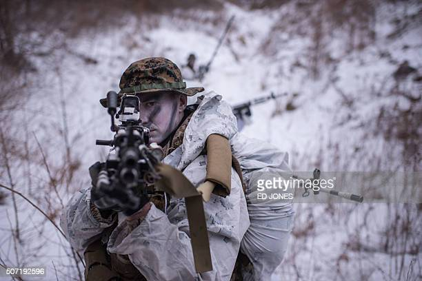 US soldier poses for photographers during a joint annual winter exercise in Pyeongchang some 180 kilometers east of Seoul on January 28 2016 The...