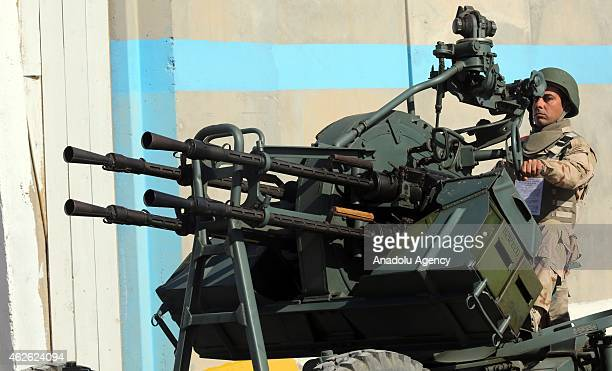 A soldier poses with an artillery during a military parade marks 22th anniversary of the foundation of the Iraqi Air Defense Forces in Baghdad Iraq...
