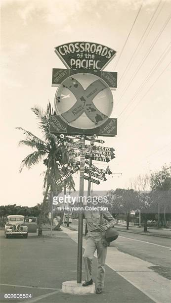 Soldier posing by Crossroads of the Pacific sign