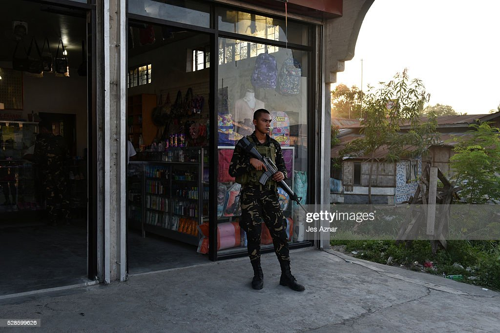 A soldier position himself outside a store in Shariff Aguak, Maguindanao, Philippines on May 6, 2016, just a few days before the country's national elections. Philippine authorities has put its military and police forces on red alert in preparation for the upcoming elections on May 9. During election season, the country records a high rate of election-related violence, with 145 cases during the last 2013 polls.