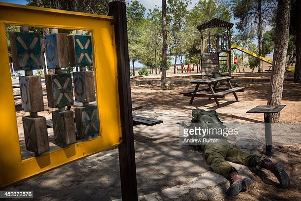 A soldier positions himself amongst a children's playground while on an operation near the IsraeliGaza border on July 19 2014 near Sderot Israel As...