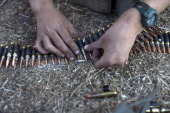 A soldier prepares ammunition as Israeli troops start preparations at a deployment area during a military exercise on August 28 2013 near the border...