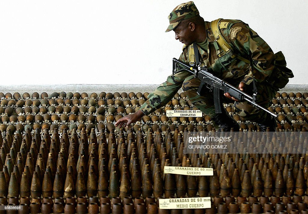 A soldier prepares ammunitions seized to the 47th squad of the Revolutionary Armed Forces of Colombia (FARC), before being displayed to the press 02 October 2005 in Rionegro, Antioquia. The 4th Brigade seized a large quantity of ammunitions belonging to the FARC in the Colombian district of San Francisco in the east of Antioquia, including 622 60mm and 32 81mm grenades and abundant military equipment. AFP PHOTO/Gerardo GOMEZ