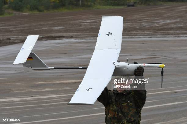 A soldier prepares to start an 'EMT Aladin' airborne closein range imaging reconnaissance drone of the German armed forces Bundeswehr during the...