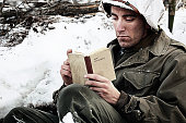 World War 2 soldier reading a New Testament.