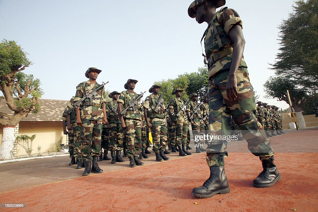 A soldier reviews Senegalese troops in the Captain Moussa Dioum military camp of Bargny, near Dakar, on February 2, 2013 in Dakar, before their departure for Mali as part of the second contingent of Senegalese troops to back Malian forces. President Francois Hollande arrived in Mali Saturday to push for African troops to replace French forces who led a lightning advance that drove back radical Islamists from the country's desert north. BEHAN