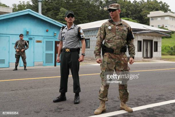 A US soldier right and South Korean soldiers stand guard at the truce village of Panmunjom in the Demilitarized Zone in Paju South Korea on Thursday...