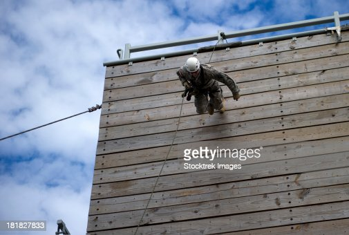 A U.S. Soldier runs down a 40-foot rappelling wall.