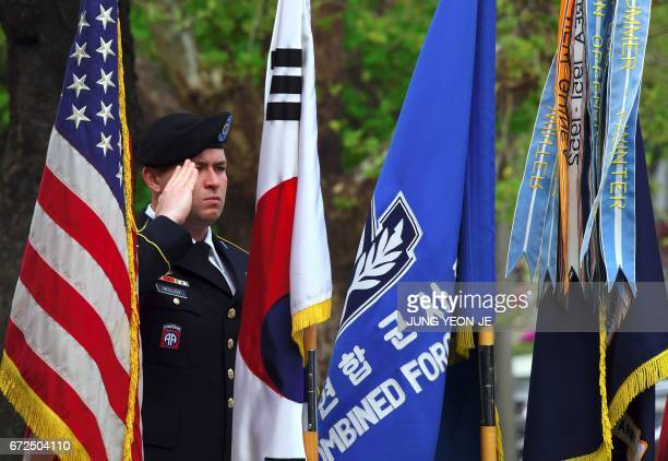 A US soldier salutes during the General Walker Monument Transition Ceremony at a US Army base in Seoul on April 25 2017 marking the beginning of the...