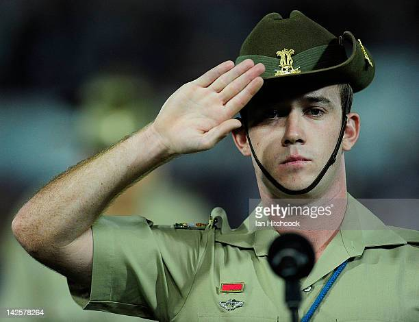 A soldier salutes during the national anthem before the start of the round six NRL match between the North Queensland Cowboys and the Melbourne Storm...