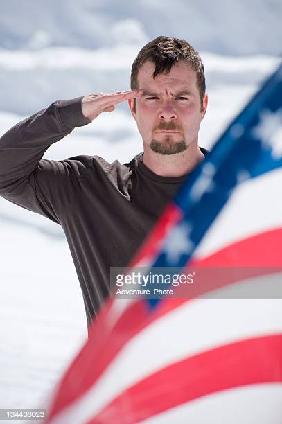 Soldier Salutes the American Flag and Honors a Fallen Comrade
