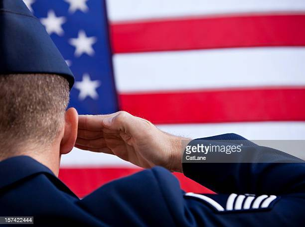 Soldier saluting American flag